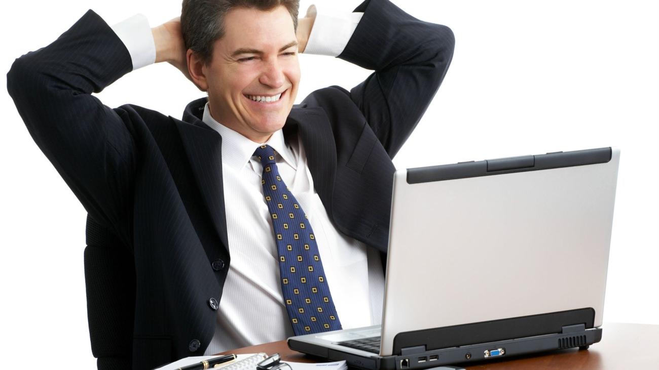photoxpress_7152112-happy-business-man-at-laptop-business-man